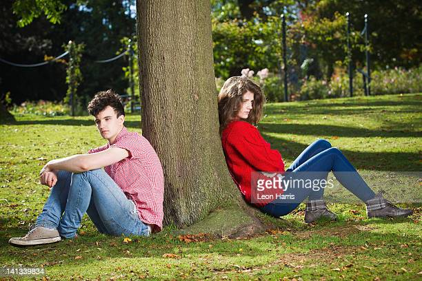 Teenage couple arguing in park