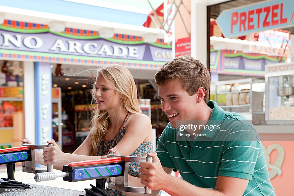 Teenage couple at shooting gallery : Stock Photo