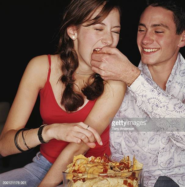 teenage couple (15-18) eating nachos - open collar stock photos and pictures