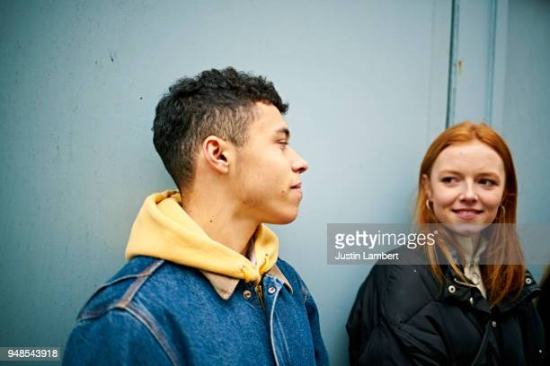teenage couple having a moment together while hanging out with friends - petite amie photos et images de collection