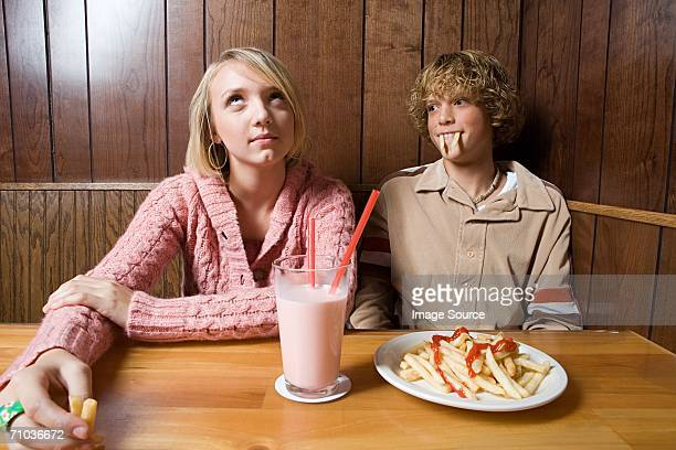 Teenage couple in a cafe