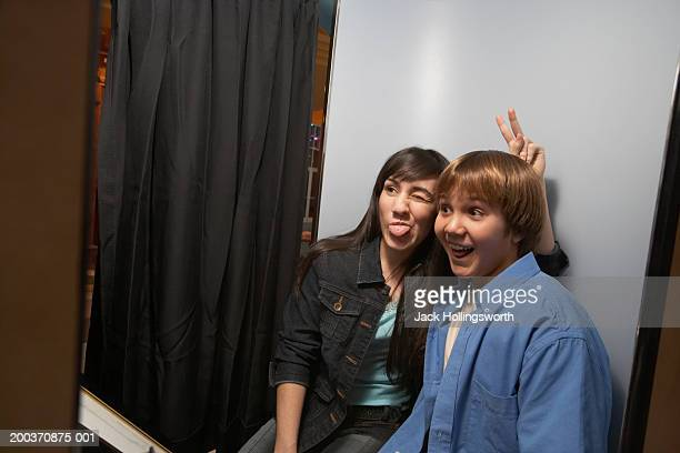 Teenage couple in a photo booth