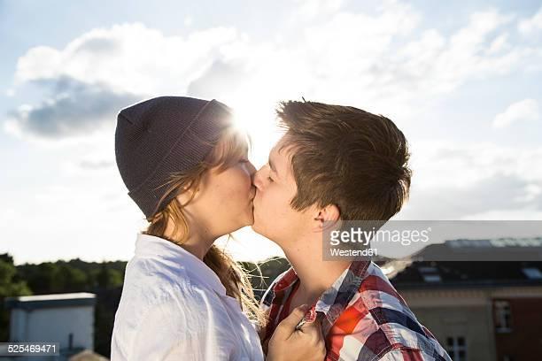 Teenage couple kissing outdoors