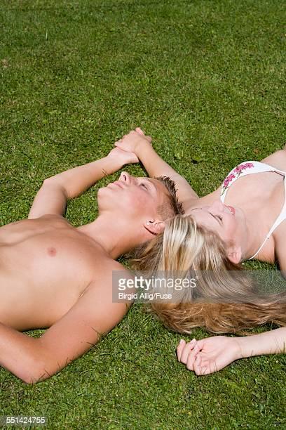 Teenage Couple Lying on Grass