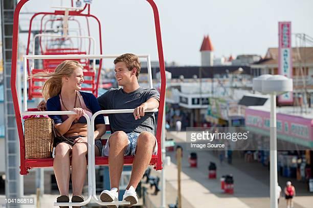 Teenage couple on ferris wheel