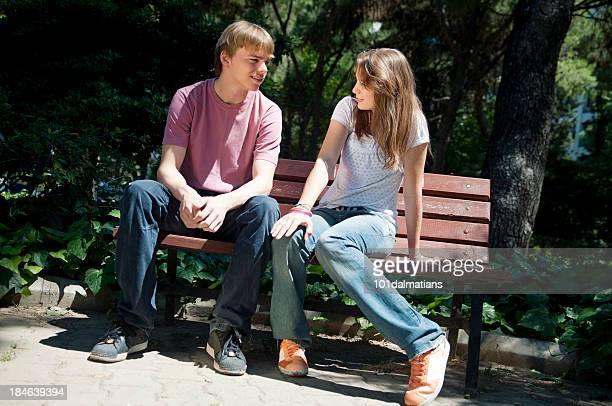 Teenage couple on the bench