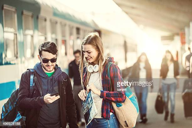 Teenage couple on the railway station