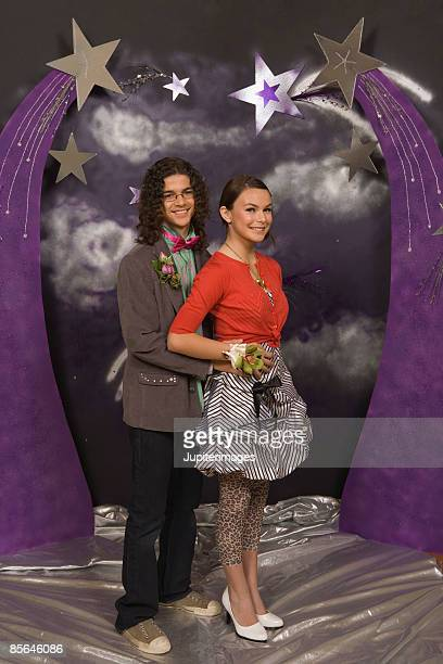 Teenage couple posing for prom portrait