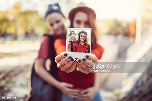 Teenage couple sharing a photo