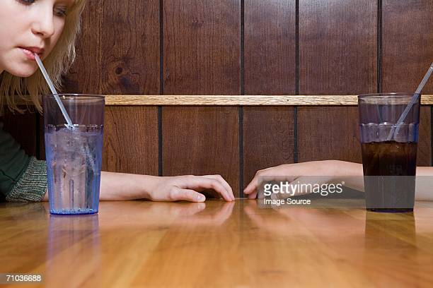 teenage couple sitting in a cafe - teenage couple stock photos and pictures
