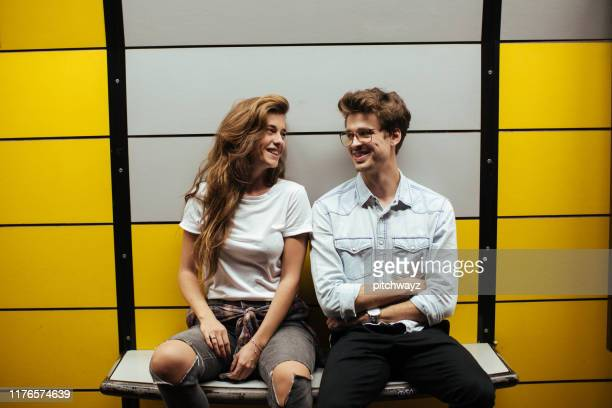 teenage couple sitting in subway on bench. - subway station stock pictures, royalty-free photos & images