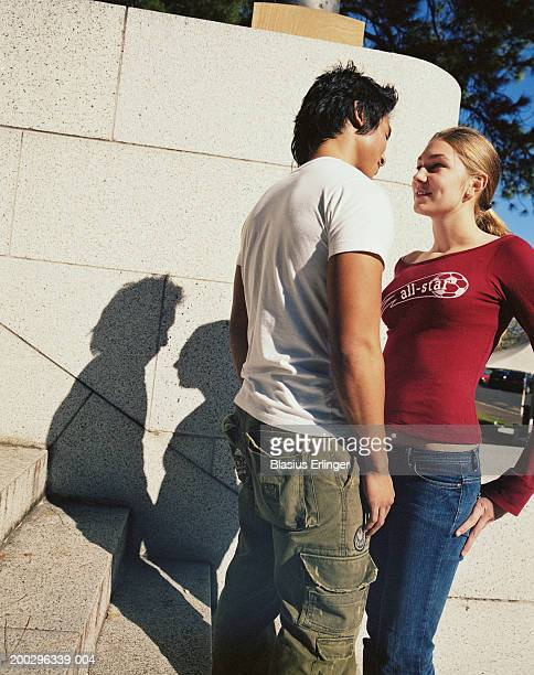 teenage couple (15-20) smiling at each other - blasius erlinger stock pictures, royalty-free photos & images