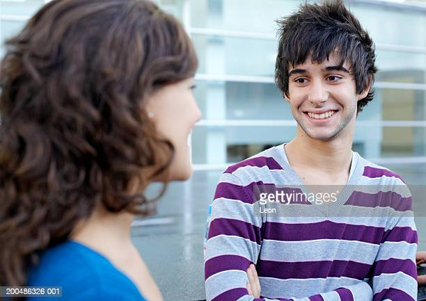 Teenage couple (16-18) talking