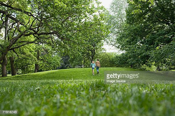 Teenage couple walking in a park