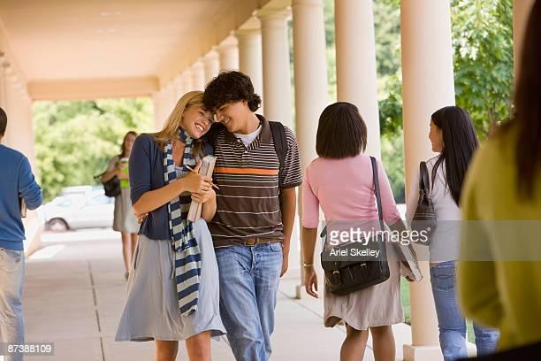 Teenage couple walking together