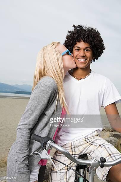 Teenage couple with bicycle