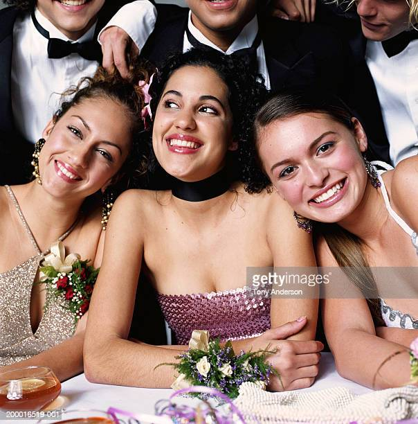 Teenage couples (16-18) at prom, table, close up