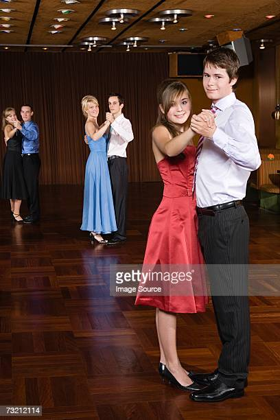 Teenage couples ballroom dancing