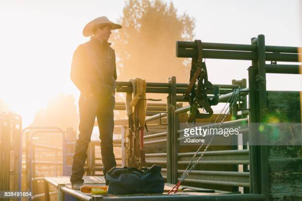 Teenage cowboy pensively looking into the distance