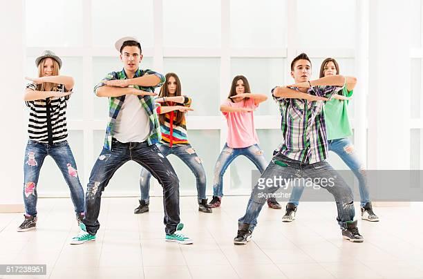 Teenage dancers dancing.