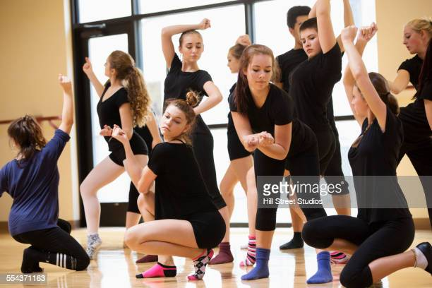teenage dancers rehearsing in studio - daily sport girls stock pictures, royalty-free photos & images