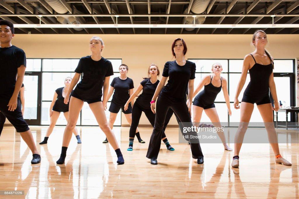Teenage dancers rehearsing in studio : Stock Photo