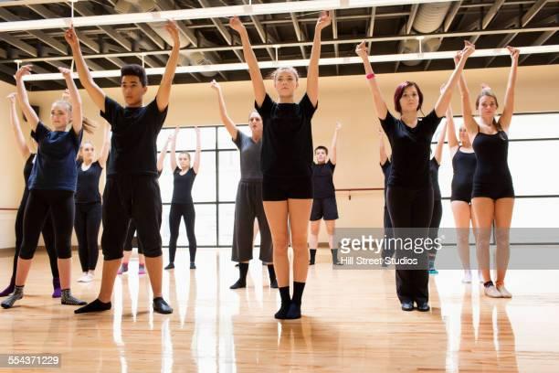Teenage dancers rehearsing in studio