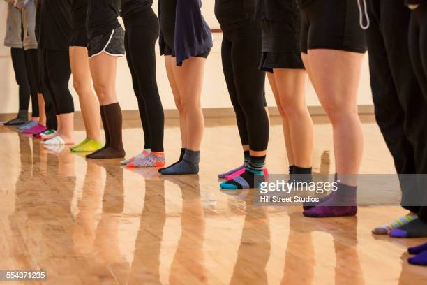 teenage dancers standing in a row in studio - girls in socks stock photos and pictures