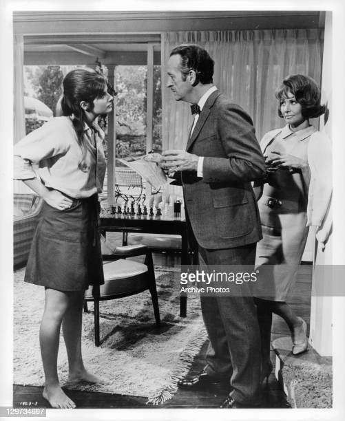 Teenage daughter Cristina Ferrare doesn't agree with father David Niven while mother Lola Albright looks on in a scene from the film 'The Impossible...