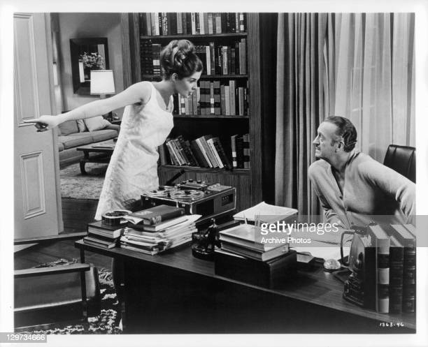 Teenage daughter Cristina Ferrare questions father David Niven in a scene from the film 'The Impossible Years' 1968