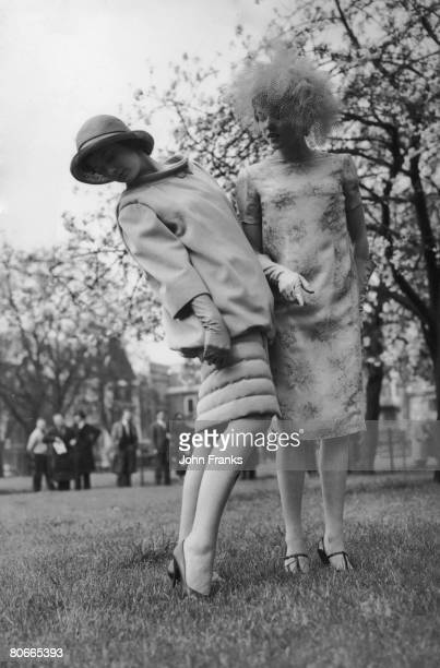 Teenage debutantes Diane Kirk and the Hon Penelope Allsopp modelling outfits by French fashion designer Pierre Cardin in Green Park London 28th April...