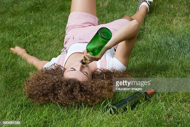 Teenage drinking problem Girl with beer bottle.