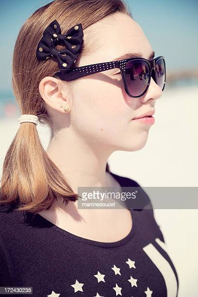 "teenage fashion on the beach, vertical. - ""martine doucet"" or martinedoucet stock pictures, royalty-free photos & images"