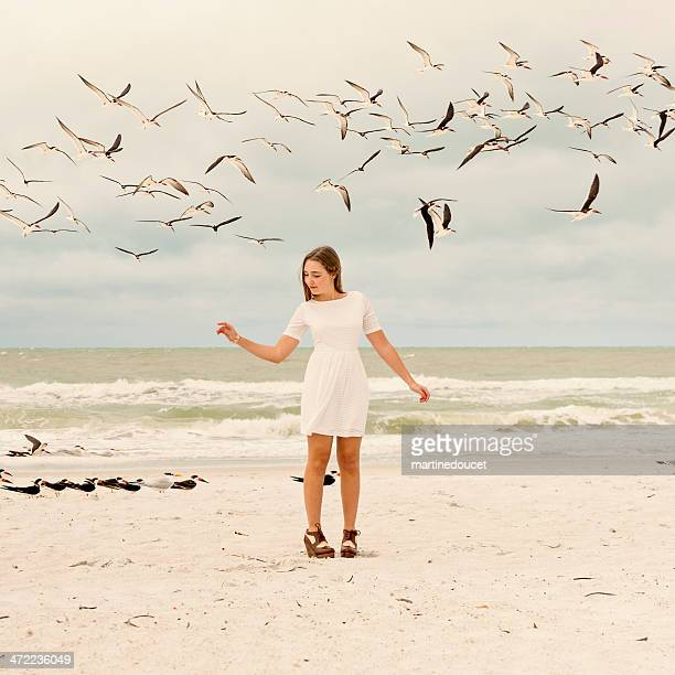 """teenage fashion on the beach with birds. - """"martine doucet"""" or martinedoucet stock pictures, royalty-free photos & images"""