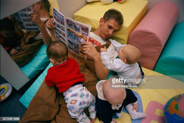 Teenage Father and Son at Daycare Center