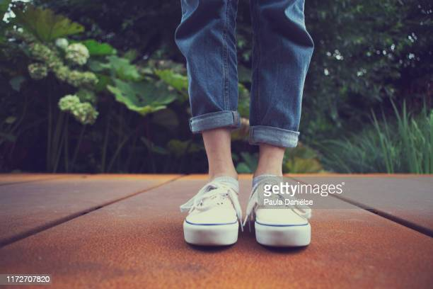 teenage feet - rolled up pants stock pictures, royalty-free photos & images