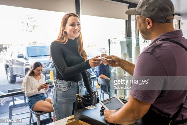 Teenage Female Customer Buying Coffee at a Coffee Shop
