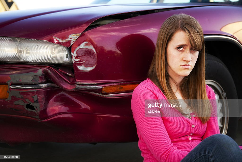 Teenage Female Driver Glares at Camera over Fender Bender : Stock Photo