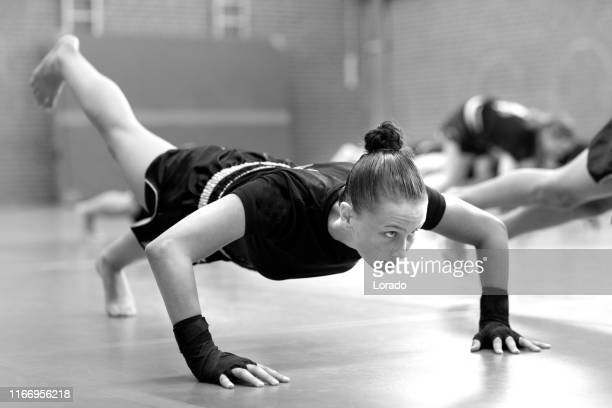 teenage female fighter girl in a public gym - martial arts stock pictures, royalty-free photos & images