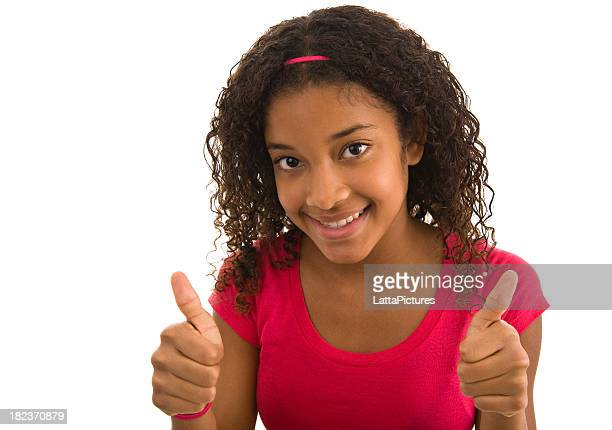 Teenage female giving the thumbs up with both hands