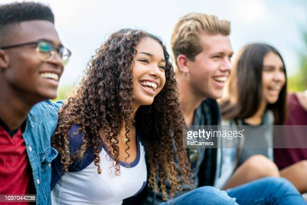 Teenage friends laughing outside