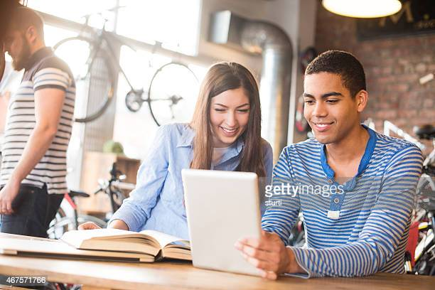 teenage friends studying in a coffee shop
