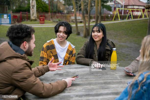 teenage friends talking - alternative pose stock pictures, royalty-free photos & images