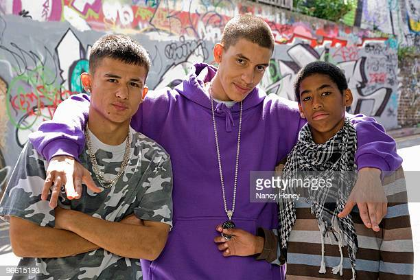 teenage gang against graffiti wall - gang stock pictures, royalty-free photos & images