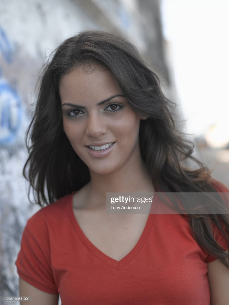 Teenage girl [16-17] in red shirt smiling, portrait. : Stock Photo