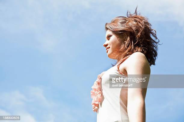 Teenage girl against blue sky