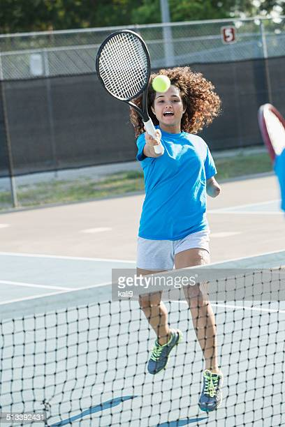 teenage girl amputee playing tennis - drive ball sports stock pictures, royalty-free photos & images