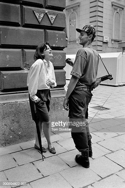 Bosnia Sarajevo July 1992 A teenage girl and a young Bosnian fighter with an AK47 flirt on a street corner during a break in shelling During the 47...