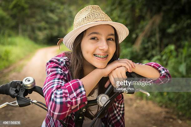 teenage girl and bicycle - brace stock pictures, royalty-free photos & images