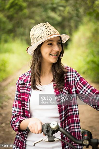 teenage girl and bicycle - beautiful girl smile braces vertical stock photos and pictures